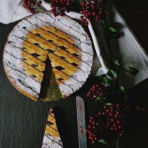 Raspberry pie with a powder sugar edge.